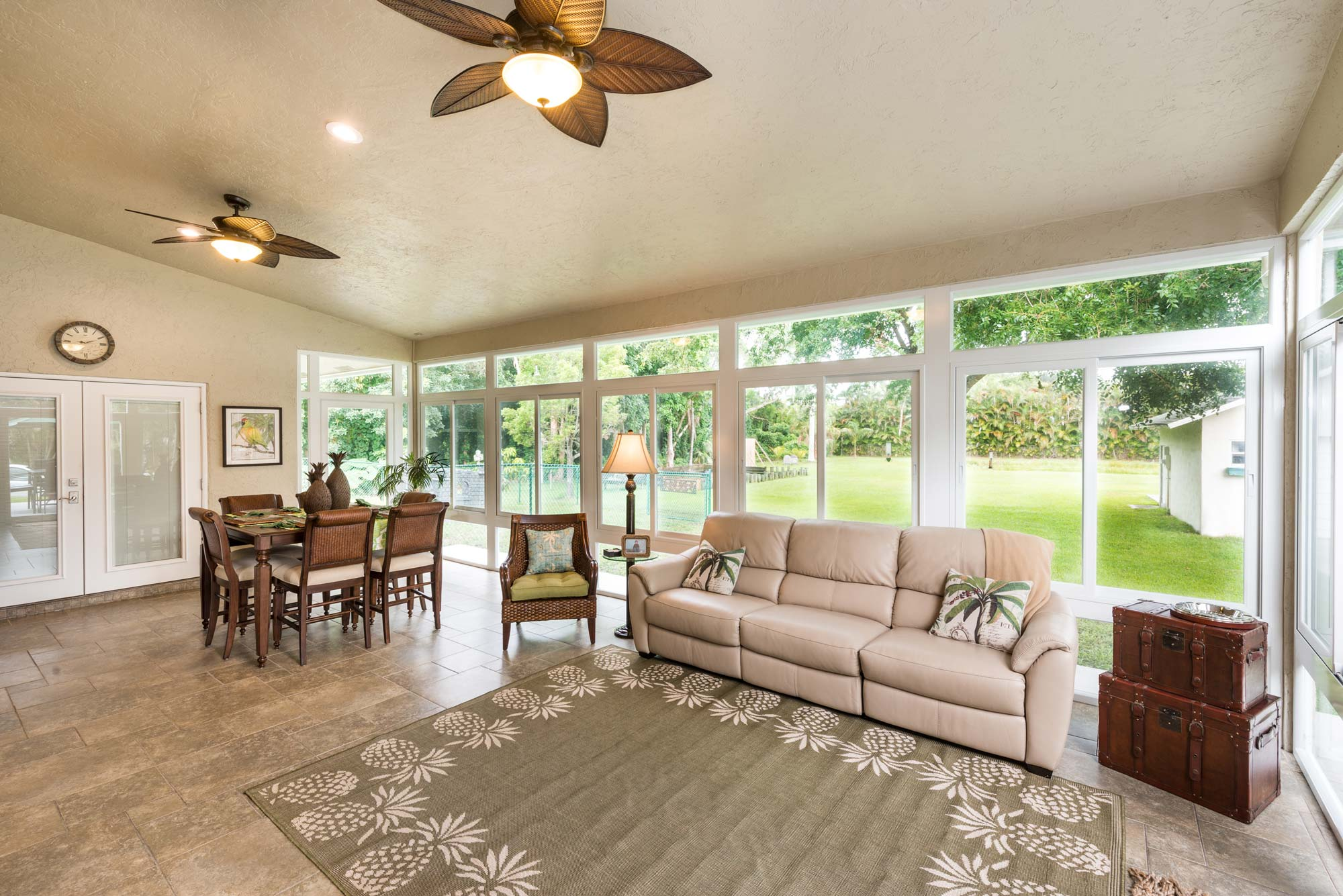 Impact-Glass-Sunroom-added-to-a-ranch-style-florida-home