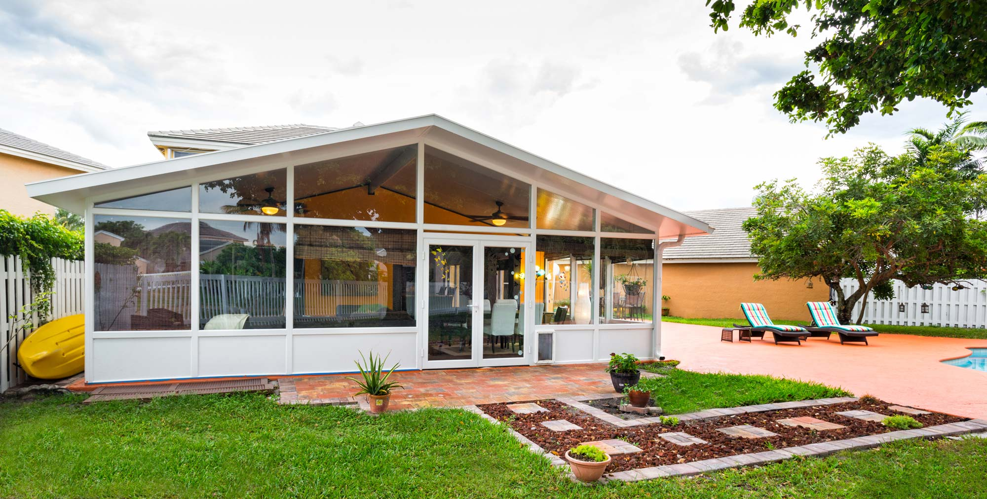 Sunroom-with-a-gable-roof-and-insulated-impact-glass-for-the-ultimate-in-comfort-and-protection
